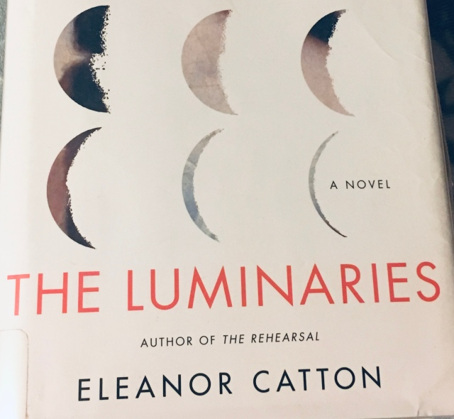 Close-up on the book cover of The Luminaries by Eleanor Catton