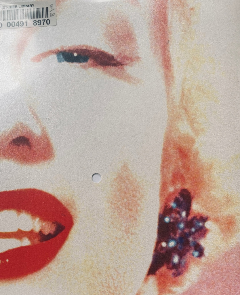 The front cover of Carol Boston Weatherford's book Beauty Mark, showing a partial photo portrait of Marilyn Monroe.