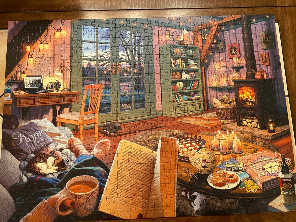 A photo of a completed jigsaw puzzle depicting a cozy indoor winter scene.