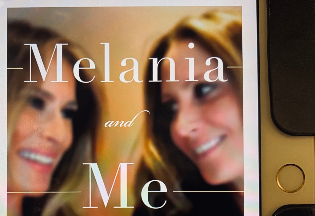 A closeup of the e-book cover for Melania and Me, showing the main title and a photo of Melania Trump and Stephanie Winston Wolcoff smiling at each other.
