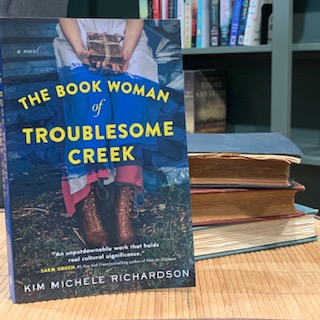 The cover of The Book Woman of Troublesome Creek by Kim Michele Richardson.