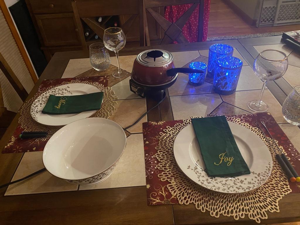 A dinner table set for fondue.