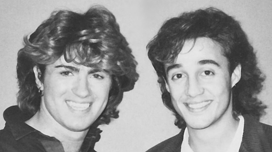 A black and white photo of the pop duo Wham! in all their mid-80s glory.