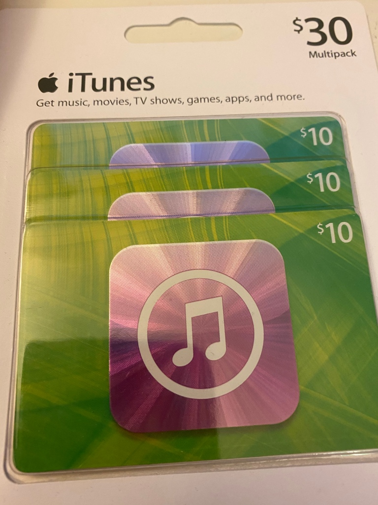 An unopened multipack of 3 $10 iTunes gift cards.