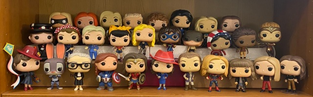 A collection of 29 Funko Pop! figures displayed in 3 rows. In addition to the figures named in the blog post are: Captain Marvel, Hillary Clinton, Kamala Khan, Antiope, and Daenaerys Targaeryn.