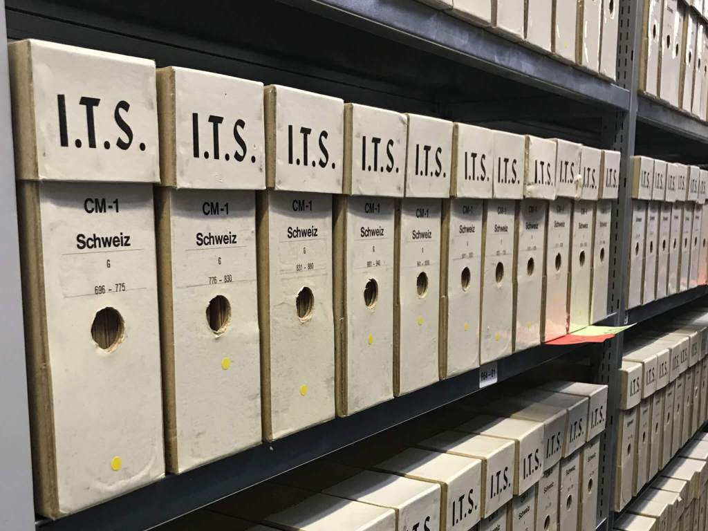 Metal shelves filed with document boxes holding a portion of the International Tracing Service (ITS) records held by the Arolsen Archives and the International Center on Nazi Persecution.